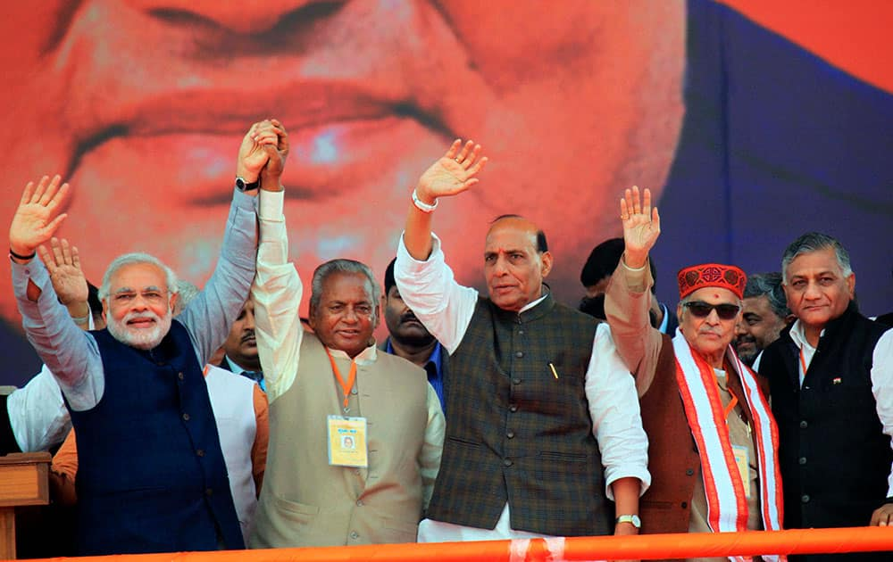BJP Prime Ministerial candidate Narendra Modi with party President Rajnath Singh, Kalyan Singh , Murli Manohar Joshi and V K Singh waves at crowd during an election campaign rally in Lucknow.