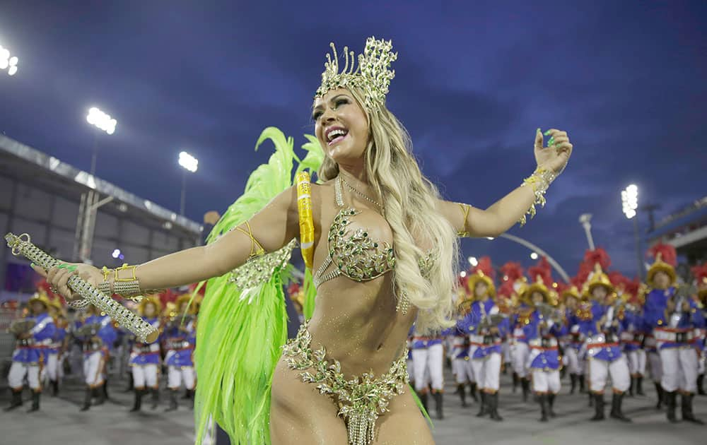 A dancer from the Academicos do Tatuape samba school performs during a carnival parade in Sao Paulo, Brazil.