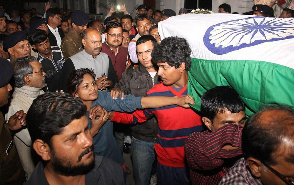 People and family members pay homage to Lt. Manoranjan who was killed in INS Sindhuratna Submarine mishap in Mumbai yard recently, when his body arrived in Jamshedpur.