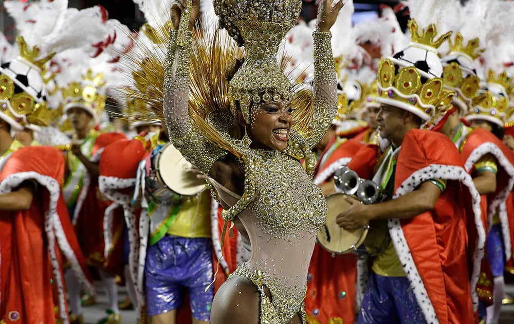 A dancer from the Leandro de Itaquera samba school performs during a carnival parade in Sao Paulo, Brazil.