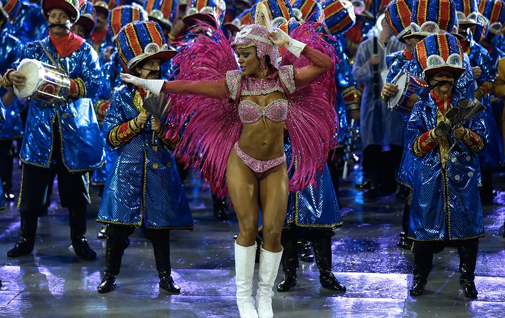 A dancer from the Dragoes da Real samba school performs during a carnival parade in Sao Paulo, Brazil.