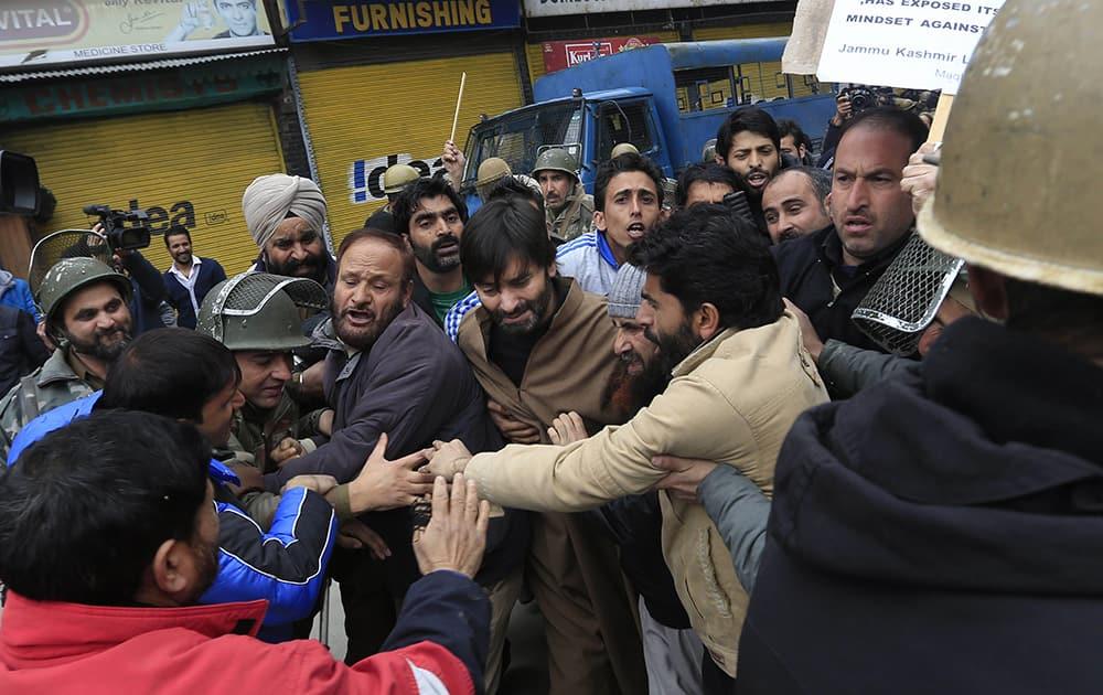 Policemen detain Jammu Kashmir Liberation Front (JKLF) chairman Yasin Malik during a protest in Srinagar.