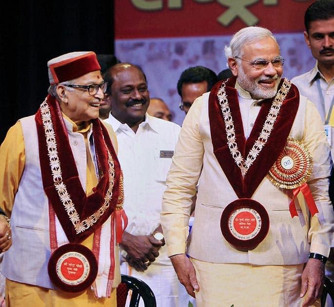 Bharatiya Janata Party (BJP)`s prime ministerial candidate Narendra Modi with senior BJP leader Murli Manohar Joshi during the Traders National Summit in New Delhi.