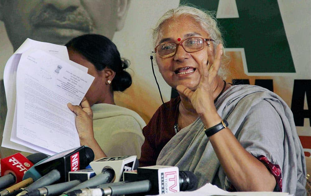 Social activist and AAP leader Medha Patkar addresses a press conference at the party office in Mumbai.