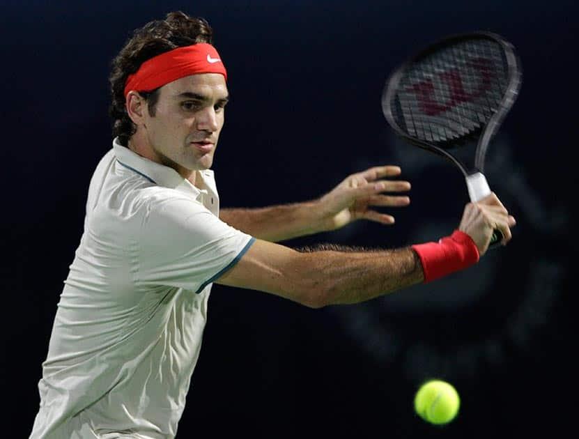 Roger Federer of Switzerland returns the ball to Radek Stepanek of the Czech Republic during the third day of the Dubai Duty Free Tennis Championships in Dubai, United Arab Emirates.