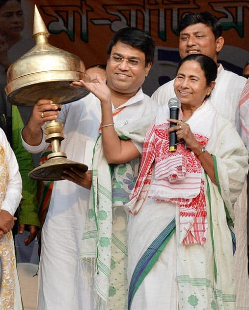 "West Bengal Chief Minister Mamata Banerjee being felicitated with Assamese traditional ""Sorai"" during ""Mother Land and its People's"" rally in Guwahati."