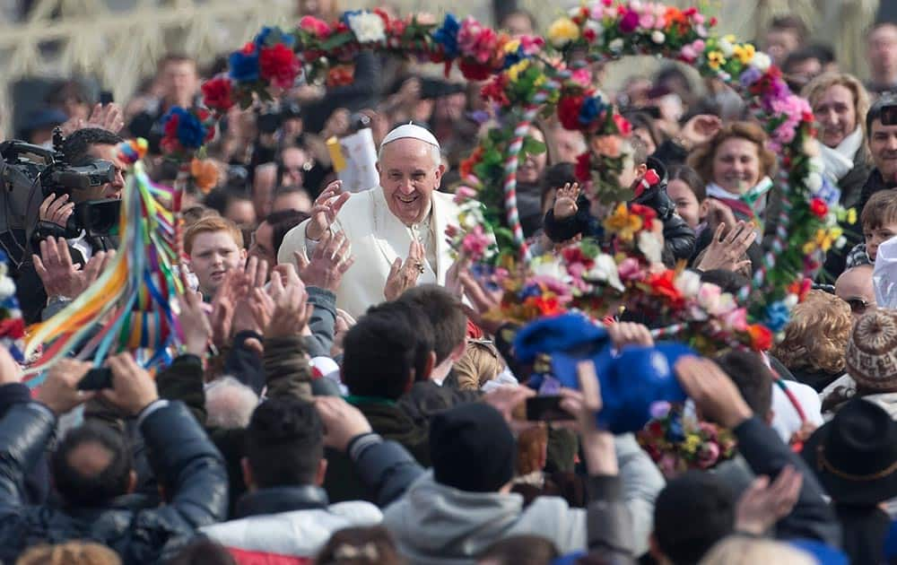 Pope Francis is cheered as he is driven through the crowd ahead of his weekly general audience in St. Peter`s Square, at the Vatican.