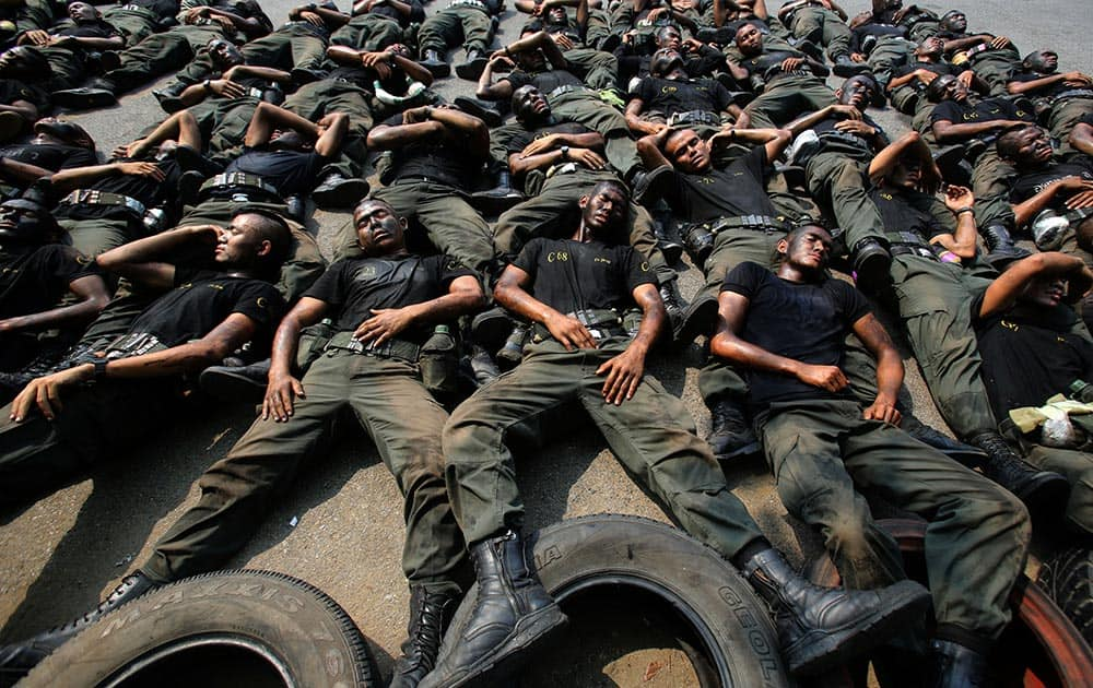 Thai police commandos take a rest during an anti terrorist exercise at Crime Suppression Division in Bangkok, Thailand.