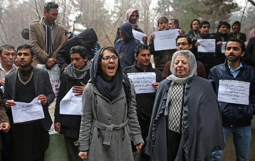 Afghan members of civil society organizations chant slogans to condemn the killing of over 20 Afghan National Army (ANA) soldiers, in a park in the Afghan capital Kabul, Afghanistan.