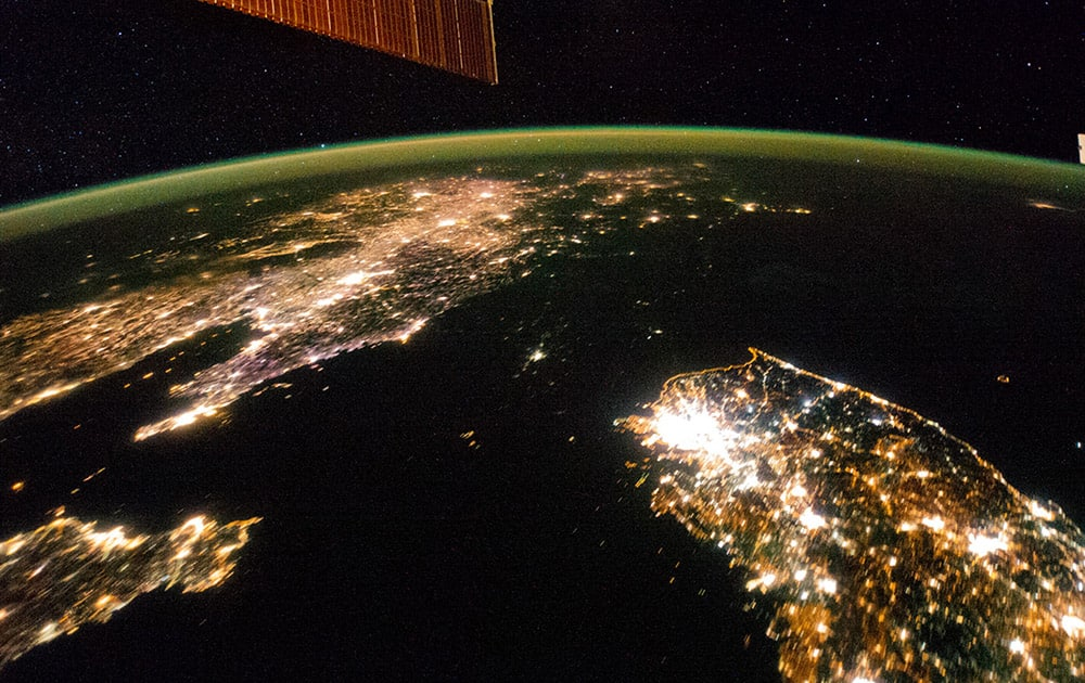 This Jan. 30, 2014 photo made available by NASA on Monday, Feb. 24, 2014 shows North Korea, darker area at center, between South Korea, right, and China, left. Lights from the North Korean capital, Pyongyang, are visible at center. The image comparing the night time lights of the countries was made by the Expedition 38 crew aboard the International Space Station.