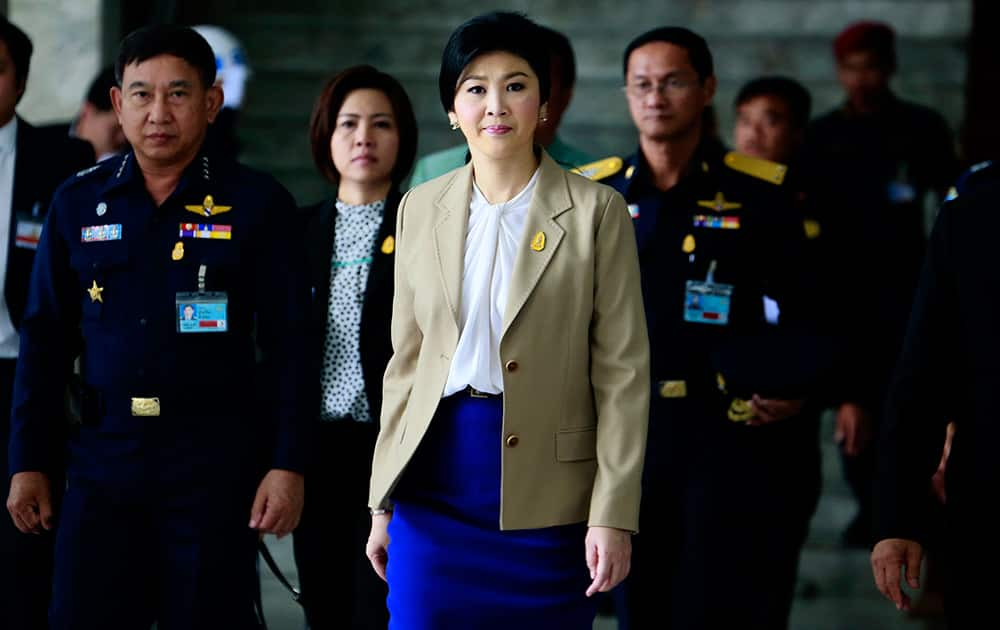 Prime Minister Yingluck Shinawatra leaves the Thai Air Force headquarters after a cabinet meeting in Bangkok, Thailand.