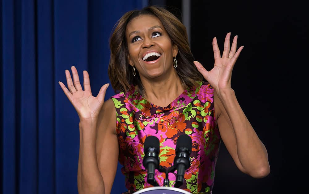 First lady Michelle Obama reacts as she introduces the cast of  `The Trip to Bountiful` after a screening the movie, in the South Court Auditorium on the White House complex in Washington.