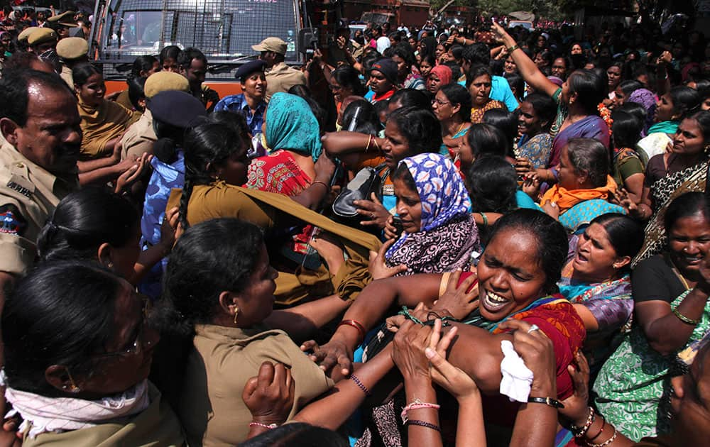 Workers of Anganwadi, or government-sponsored childcare and mother care, tussle with police who tried to detain them during a protest in Hyderabad.