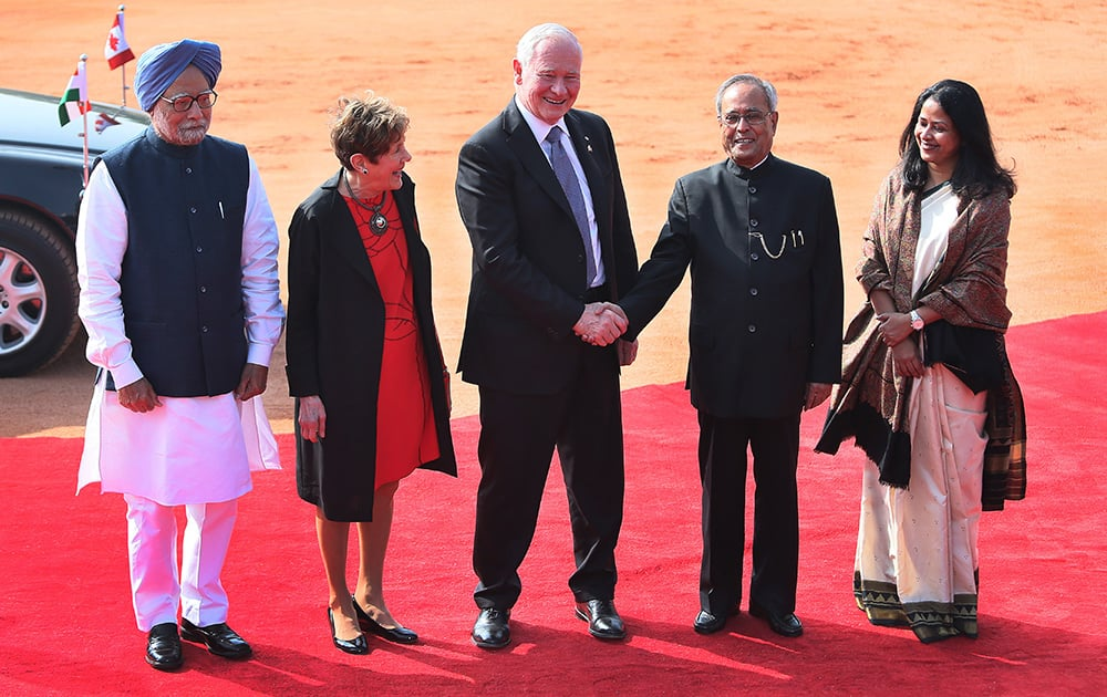 Indian President Pranab Mukherjee, second right, shakes hand with Canada's Governor General David Johnston, as Indian Prime Minister Manmohan Singh, left, Governor General's wife Sharon Johnston and Indian president's daughter Sharmistha Mukherjee, look on during Johnston ceremonial reception at the Indian presidential palace, in New Delhi.