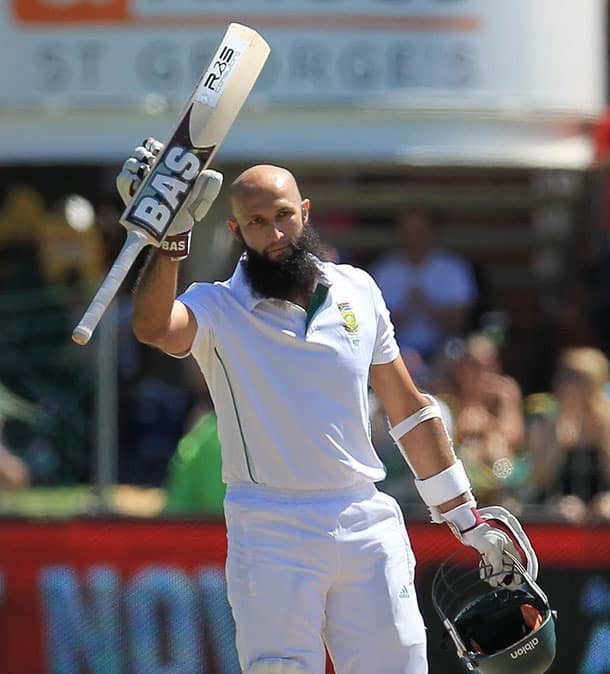 South Africa`s batsman Hashim Amla, raises his bat after reaching his century on the fourth day of their second cricket test match against Australia at St George`s Park in Port Elizabeth, South Africa.