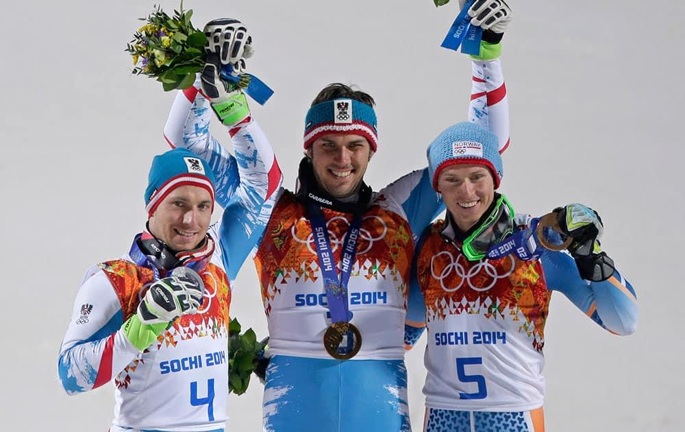 Men`s slalom winners Austria`s Mario Matt (gold), center, and his teammate Austria`s Marcel Hirscher (silver), left, celebrate on the podium with bronze medal winner, Norway`s Henrik Kristoffersen, right, at the Sochi 2014 Winter Olympics.