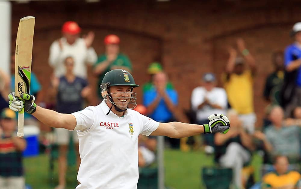 South Africa`s batsman AB de Villiers, celebrates his century on the second day of their 2nd cricket test match against Australia at St George`s Park in Port Elizabeth, South Africa.