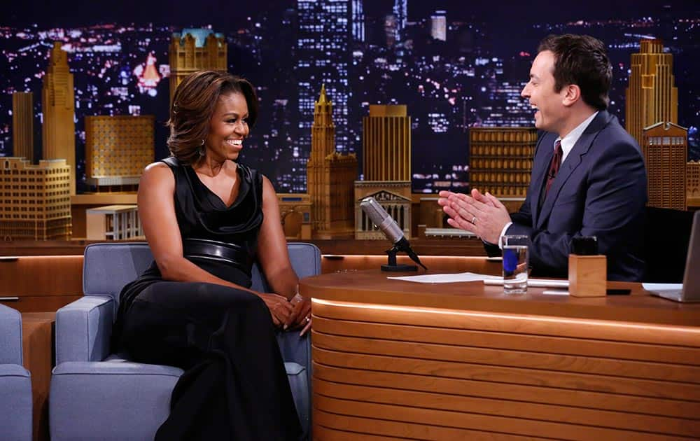 This image provided by NBC Universal First Lady Michelle Obama is seen during an interview with host Jimmy Fallon.