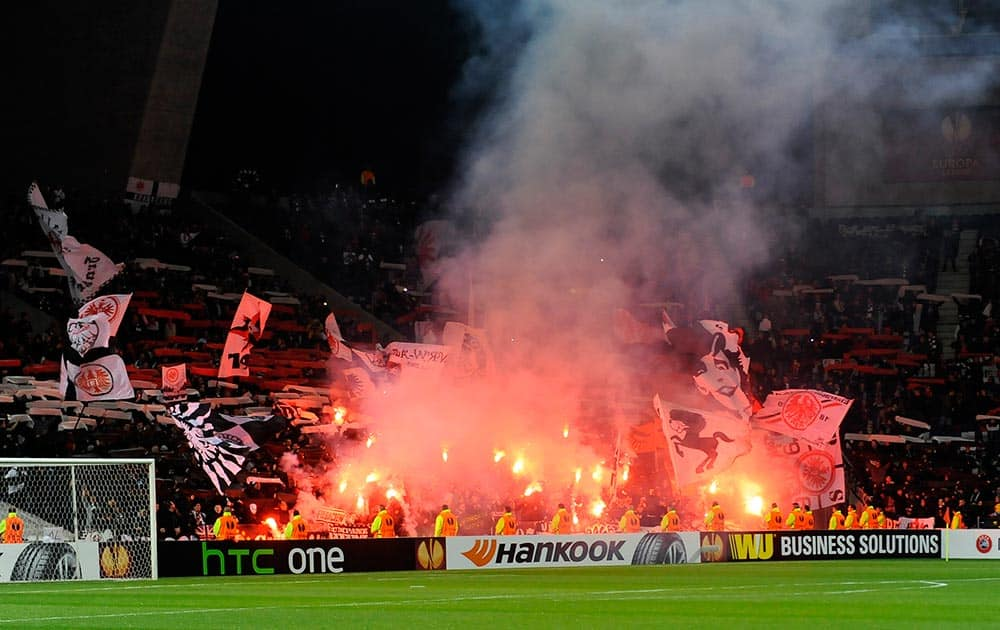 Eintracht Frankfurt`s fans light flares prior to their 2-2 draw against FC Porto during their Europa League round of 32, first leg soccer match at the Dragao stadium, in Porto, Portugal.