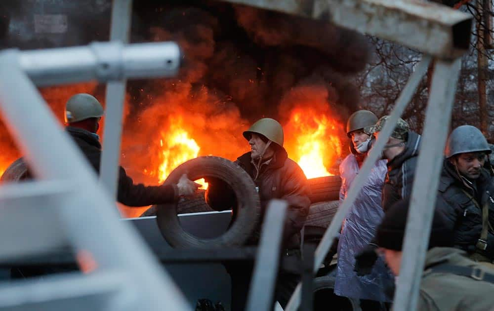 Activists burn tyres at barricades close to Independence Square, the epicenter of the country`s current unrest, in Kiev, Ukraine.