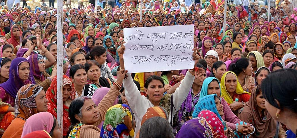 Anganwadi women display a placard against Rajasthan Chief Minister Vasundhara Raje at a protest demonstration to press for their demands in Jaipur.