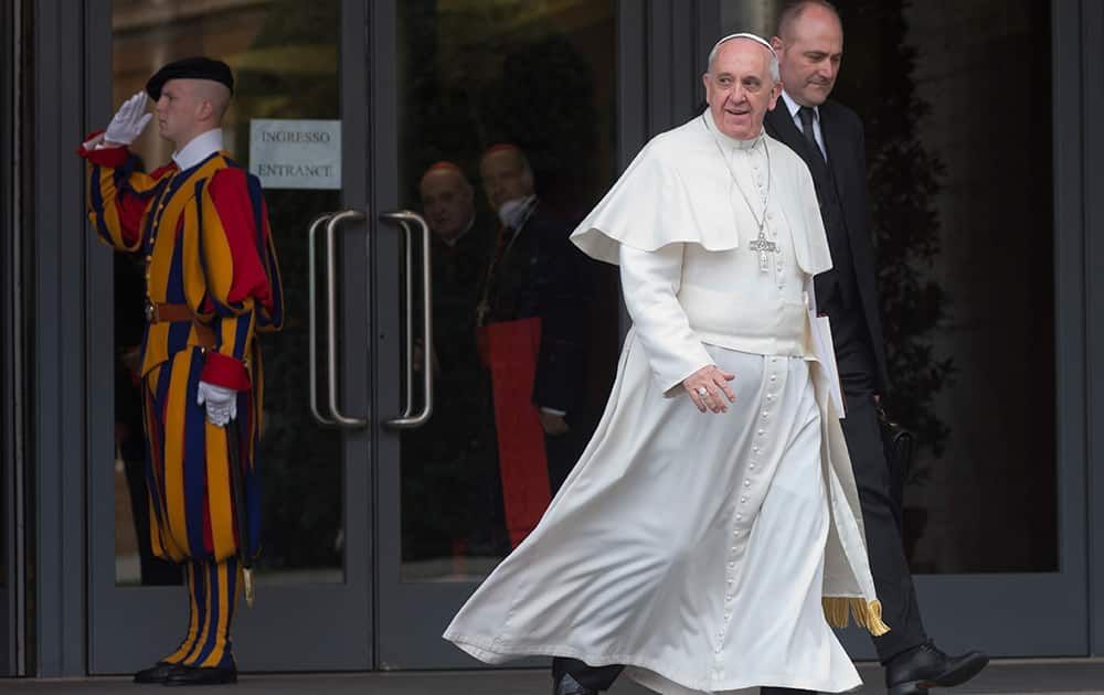 Pope Francis leaves after the first session of an extraordinary consistory in the Synod hall at the Vatican City.