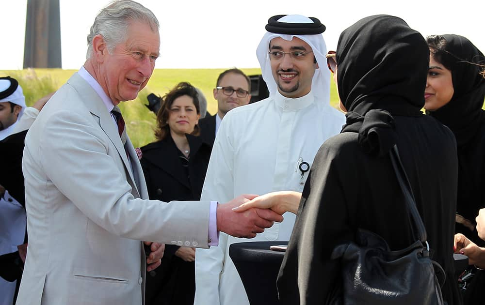 Britain`s Prince Charles meets young Qatari environmentalists in the Museum of Islamic Arts Park in Doha, Qatar.