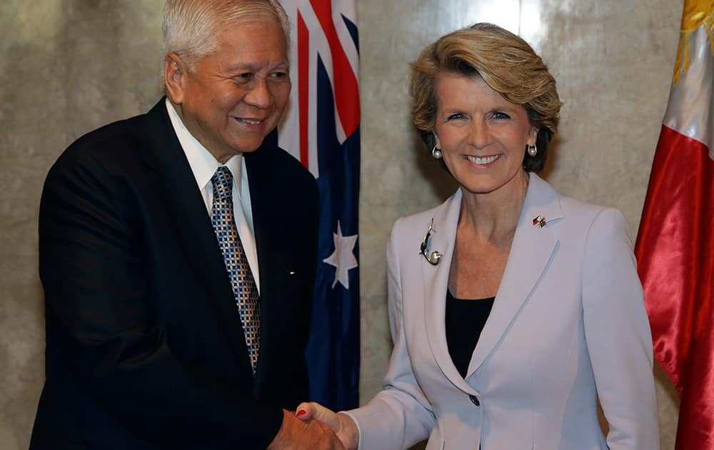 Philippine Foreign Secretary Albert del Rosario shakes hands with Australian Foreign Minister Julie Bishop as she arrives at the Department of Foreign Affairs in Manila, Philippines.