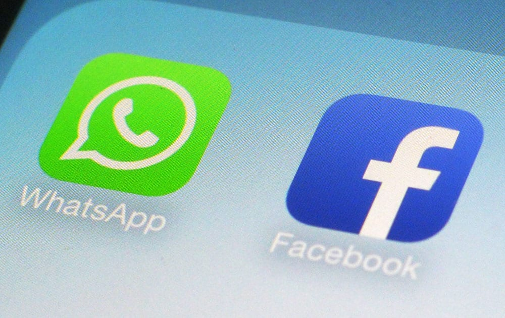 This photo shows the WhatsApp and Facebook app icons on an iPhone in New York. On Wednesday the world`s biggest social networking company, Facebook, announced it is buying mobile messaging service WhatsApp for up to $19 billion in cash and stock.