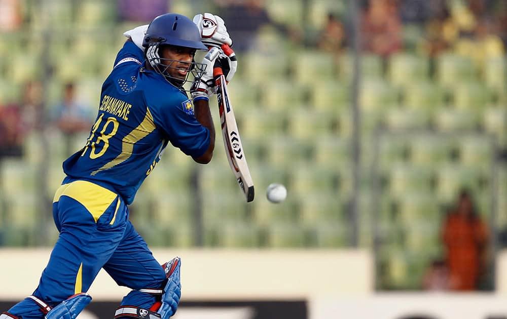 Sri Lanka's Sachithra Senanayake plays a shot against Bangladesh during their first one day international cricket match in Dhaka, Bangladesh.