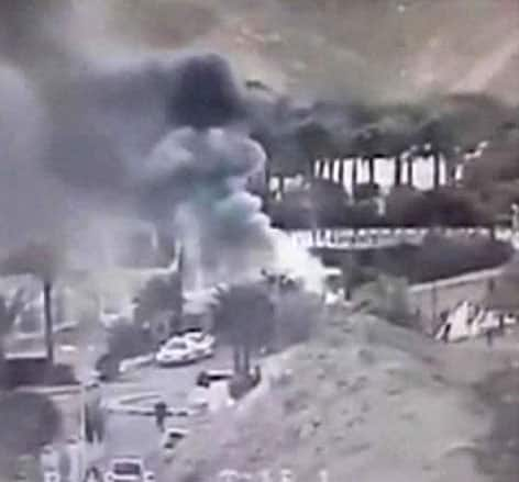 An image made from a video provided by the Israeli Airports Authority shows smoke from the bombing of the bus carrying South Korean sightseers near the tip of the Red Sea`s Gulf of Aqaba.