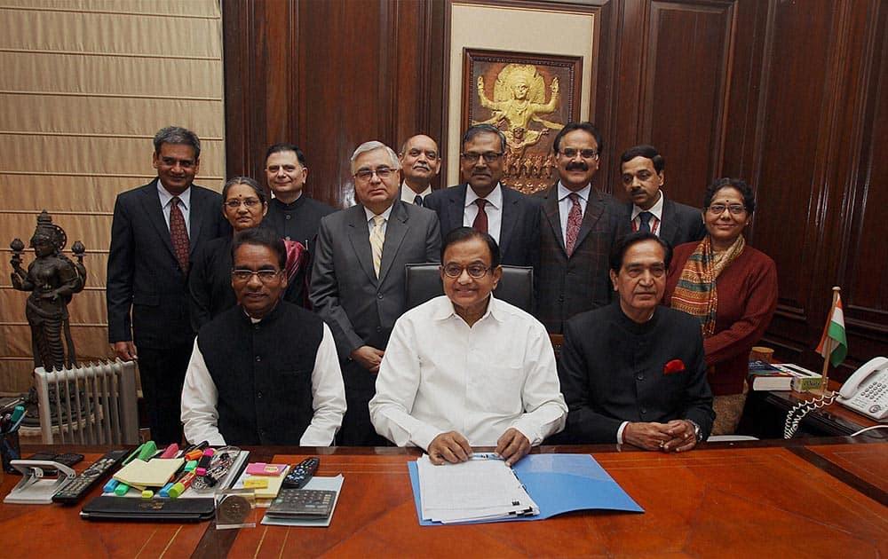 Finance Minister P Chidambaram along with MoS for Finance Namo Narain Meena and J.D. Seelam others giving final touches to the interim budget before its presentation in the Lok Sabha, in New Delhi.