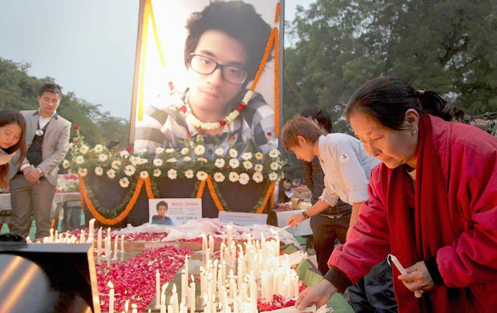 Supporters of Nido Taniam, a 20-year-old university student, light candles at Jantar Mantar in New Delhi.