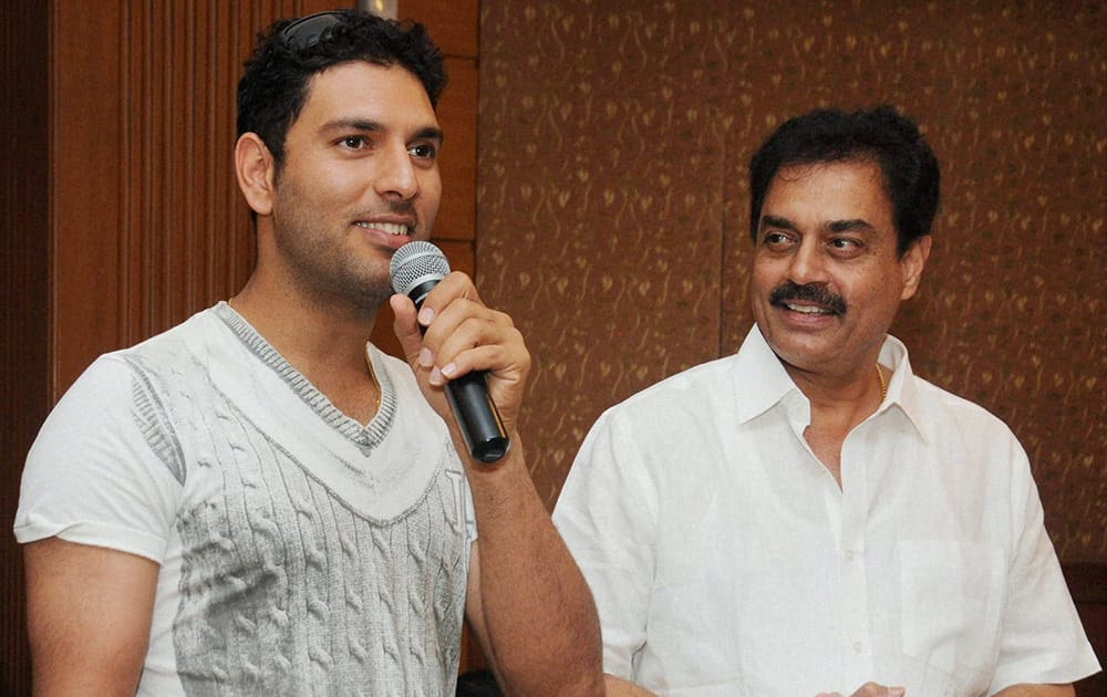Cricketer Yuvraj Singh along with former India captain Dilip Vengsarkar (R) speaks during the prize distribution function in Mumbai.