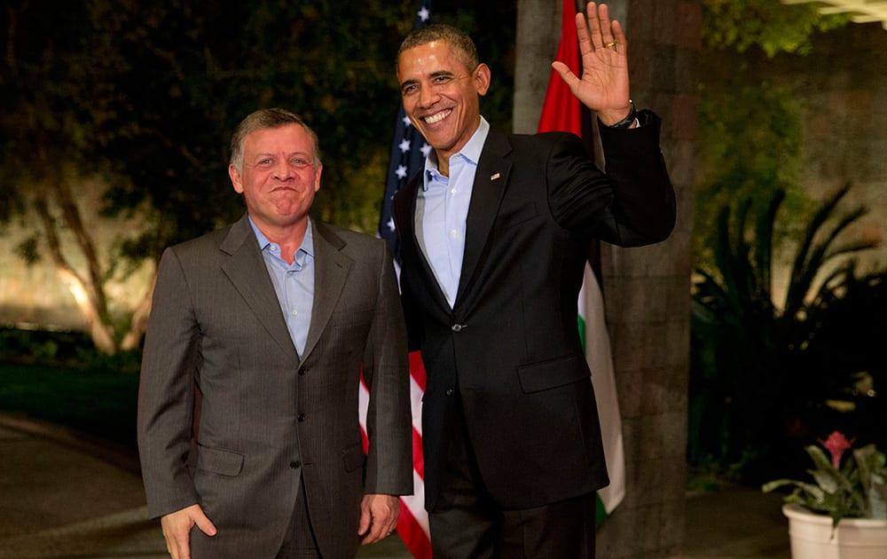 President Barack Obama waves to the media as he greets Jordan`s King Abdullah II at The Annenberg Retreat at Sunnylands, Rancho Mirage, Calif.