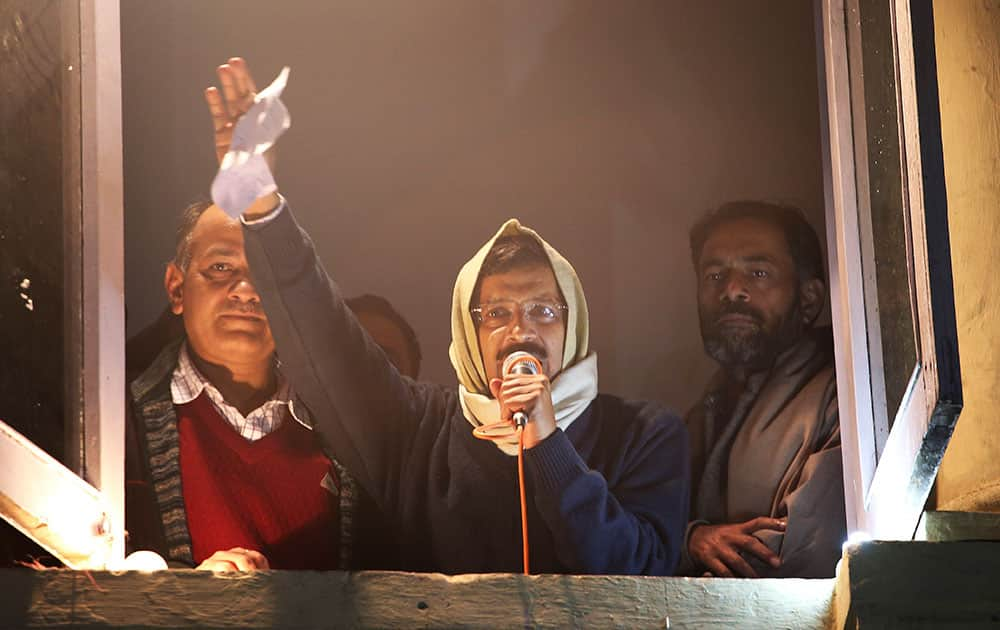 Anti-graft activist Arvind Kejriwal, center, addresses his supporters with resignation letter in his hand at Aam Aadmi Party, or Common Man's Party, headquarters in New Delhi, India.