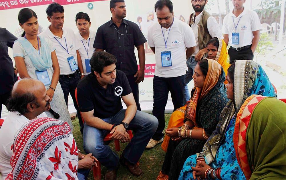 Abhishek Bachchan interacting with the people during his visit at Kunchapada cyclone shelter in Khurda.