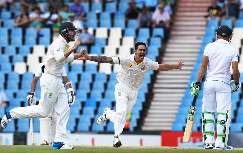 Australia`s bowler Mitchell Johnson reacts after dismissing South Africa`s batsman Faf du Plessis for 3 runs on the second day of their their cricket test match at Centurion Park in Pretoria, South Africa.