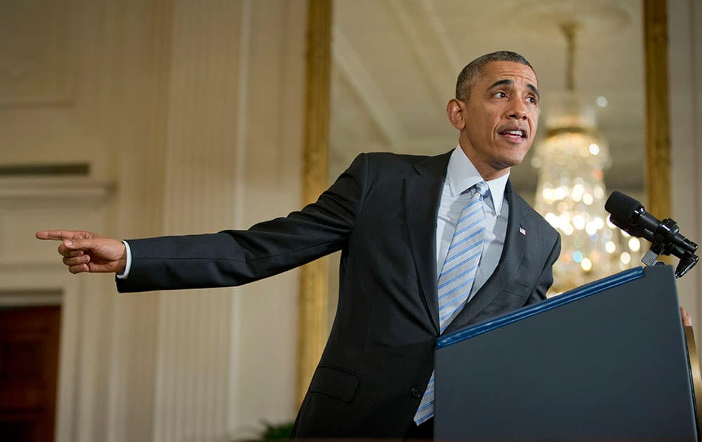 President Barack Obama gestures in the East Room of the White House in Washington, before signing an executive order to raise the minimum wage for federal contract workers.