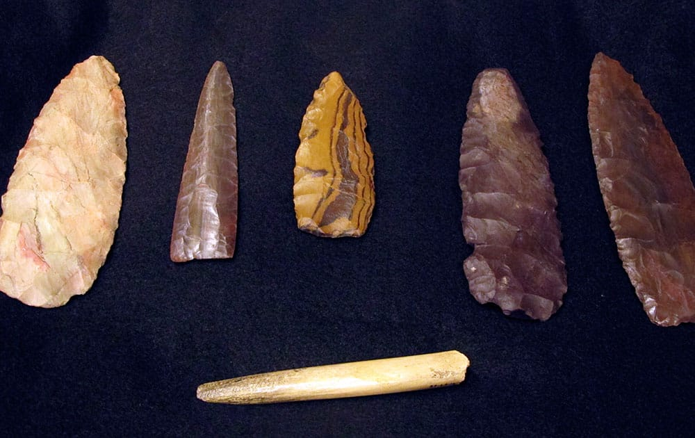 Replicas of artifacts discovered at a site at least 12,600 years old are displayed at the Montana Historical Society in Helena, Mont.