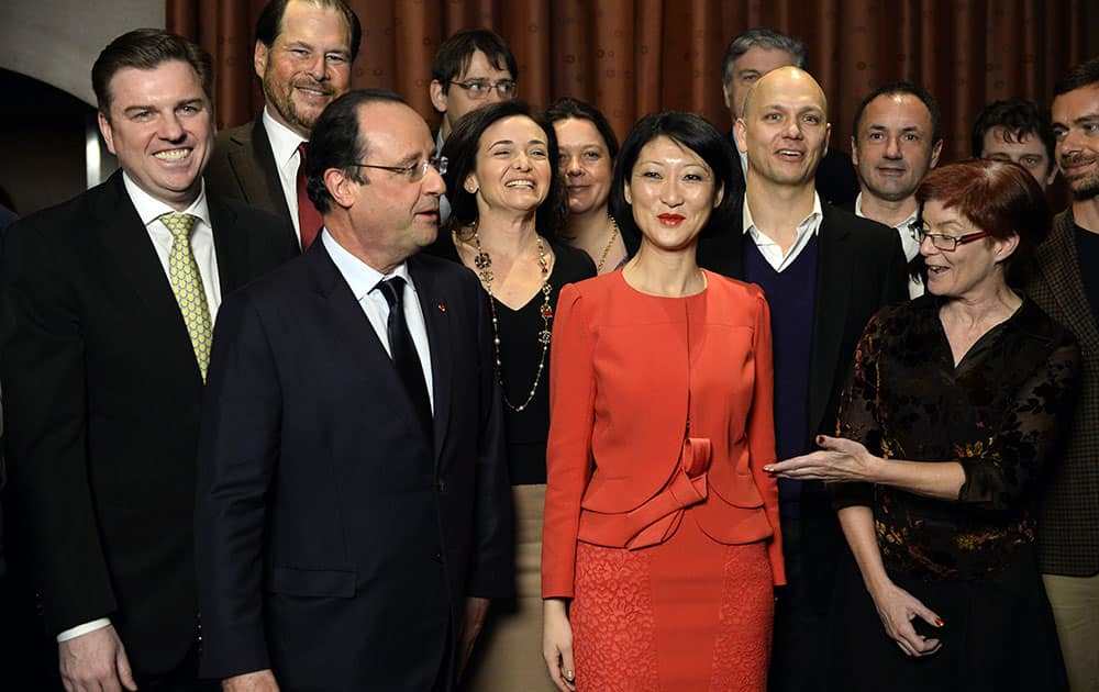 French President Francois Hollande and Minister Delegate with responsibility for Small and Medium Enterprises, Innovation, and the Digital Economy Fleur Pellerin, second from right, talk with business leaders at the restaurant