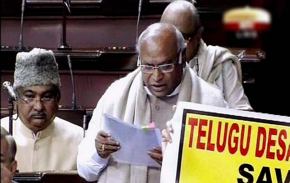 Railways Minister Mallikarjun Kharge presenting the interim rail budget in the Lok Sabha amid protest by TDP members during the extended winter session in New Delhi.