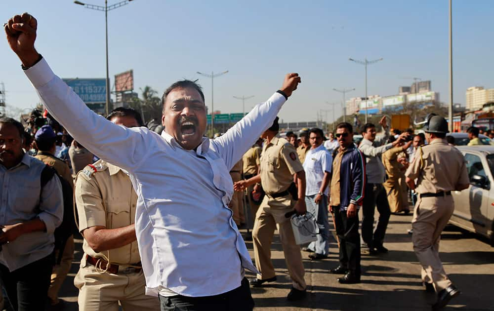A member of Maharashtra Navnirman Sena (MNS) shouts slogans as he is detained by a policeman during a protest in Mumbai. MNS has announced statewide road blocks to protest against toll collection in the state.