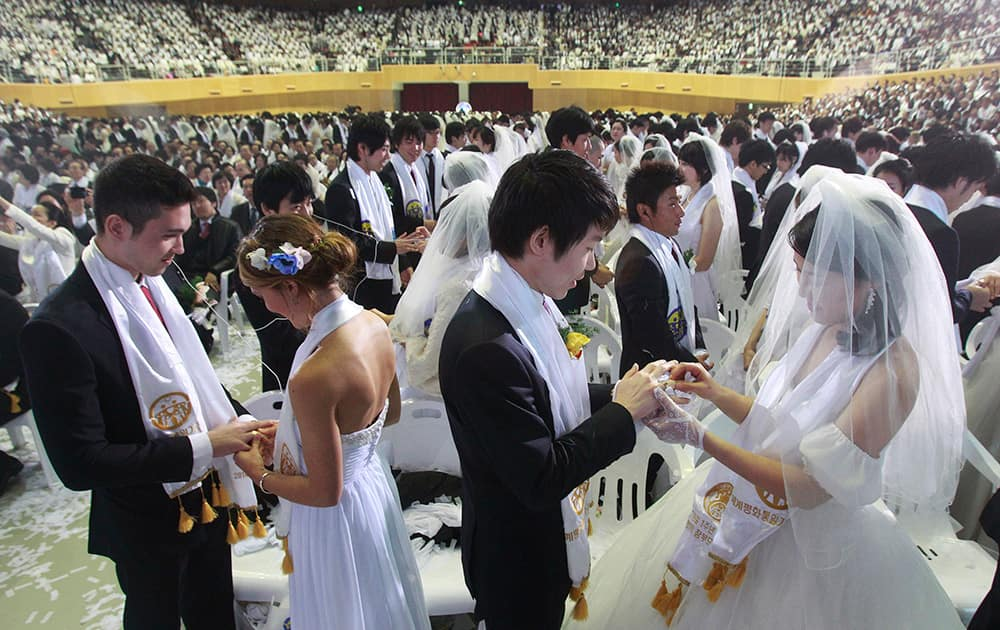 Couples from around the world exchange their rings in a mass wedding ceremony at the CheongShim Peace World Center in Gapyeong, South Korea.