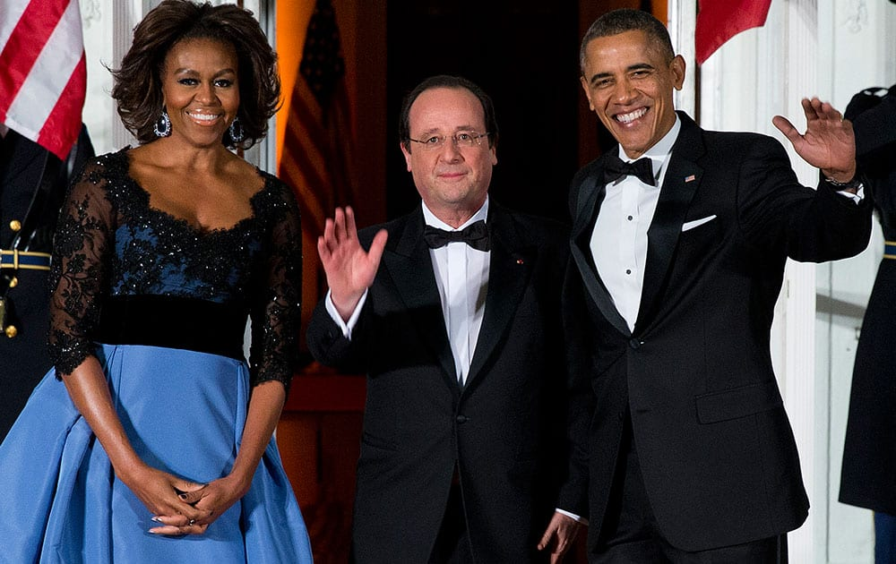 First lady Michelle Obama, left, and President Barack Obama welcome French President François Hollande for a State Dinner at the North Portico of the White House in Washington.
