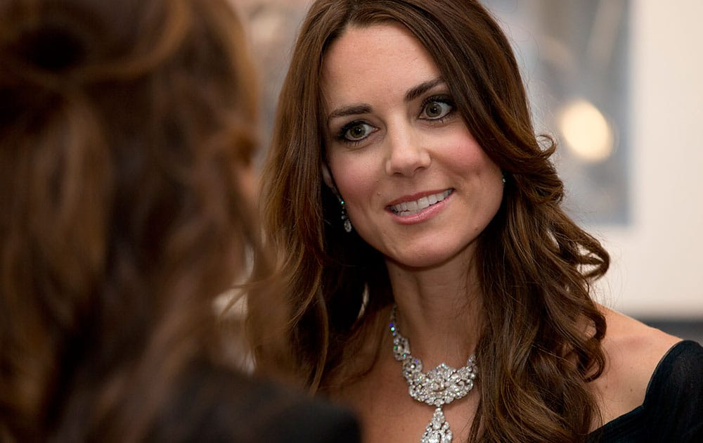 Kate Duchess of Cambridge talks to guests at a fund raising gala at the National Portrait Gallery in London.
