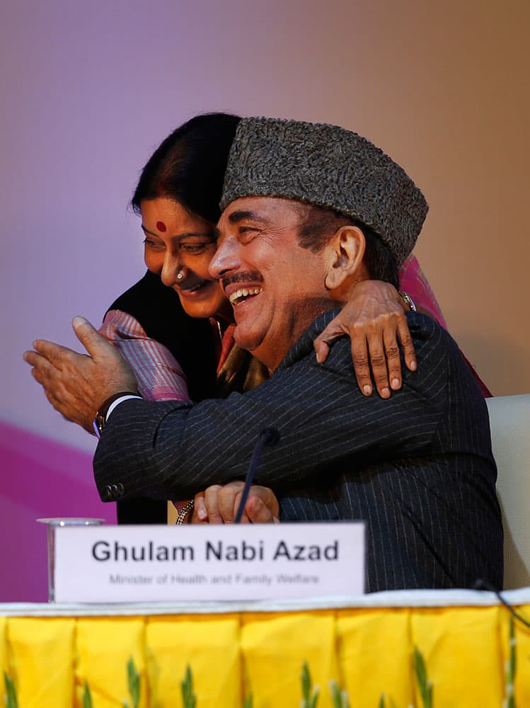 Leader of India`s main opposition Bharatiya Janata Party (BJP) Sushma Swaraj embraces Health Minister Ghulam Nabi Azad, right, at a function to celebrate the third year after India was declared polio free in New Delhi, India.