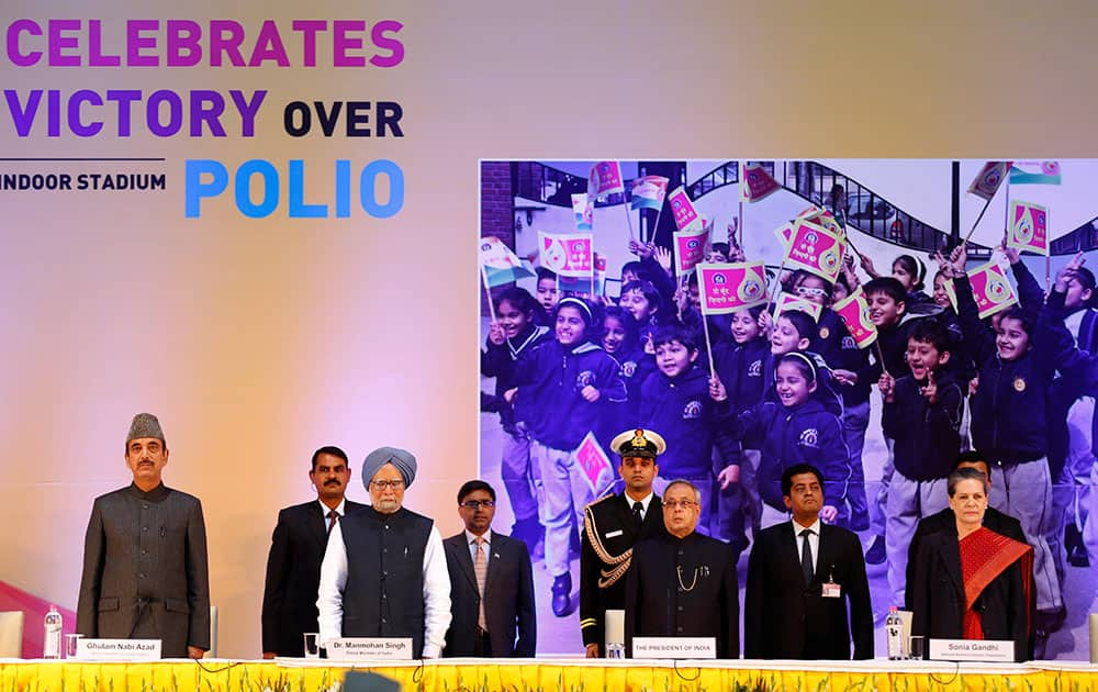 From left to right in front row, Indian Health Minister Ghulam Nabi Azad, Indian Prime Minister Manmohan Singh, Indian President Pranab Mukherjee and Congress party President Sonia Gandhi attend a function to celebrate the third year after India was declared polio free in New Delhi.