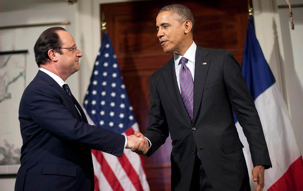 President Barack Obama and French President Francois Hollande, shake hands after talking with the media following their tour of Monticello, President Thomas Jefferson's estate, in Charlottesville, Va.