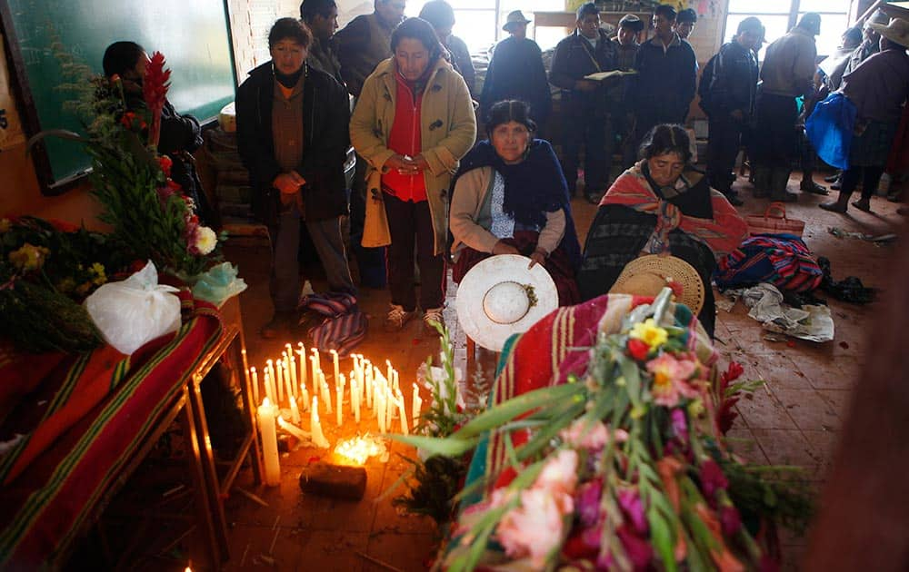People attend the wake for the persons killed by a mudslide in Chullpa Kasa, Bolivia.